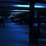 Soul Searcher's car park scene, lit almost entirely by the existing overhead fluorescents