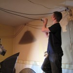Col runs power cables for a ceiling-rigged light