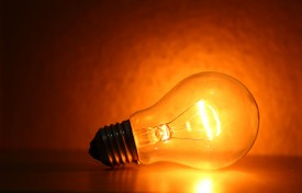 Tungsten bulbs emit an orange light - dim them down and it gets even more orangey.