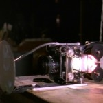 One of the custom film projectors inserted into the miniature subs