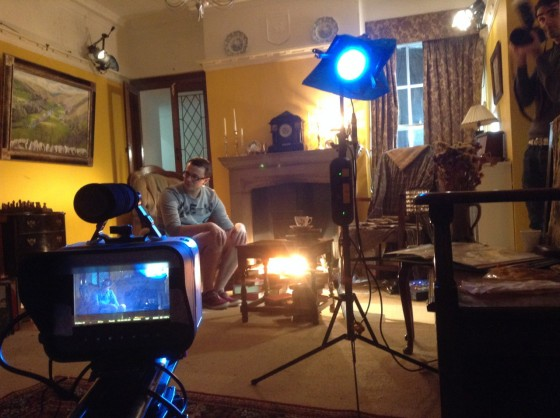 Setting up for the first living room scene. The crossed dedos can be seen in the top left and top right, while the dedo in the foreground is solely to produce lens flare.