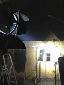 A behind-the-scenes view of the lighting set-up for the window and swords