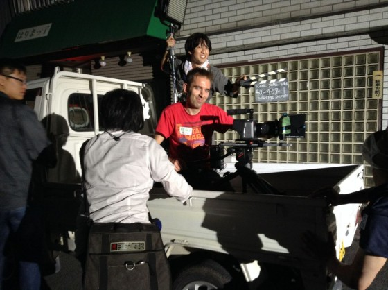 Shooting tracking shots from the back of a pick-up. Above me is camera assistant Yujiro Matsumoto with a diffused LitePanel which provides fill during the move.