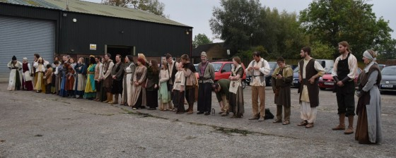 Supporting artists line up for a costume inspection in the car park of the Caxton studio. Photo: Michael Hudson