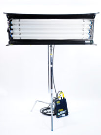 4'x4 Kino Flo with remote ballast leaning against the base of the C-stand